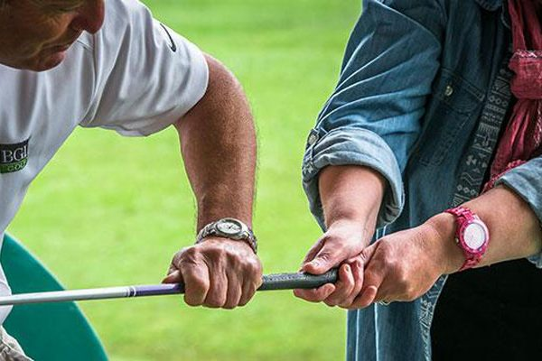 Golf lesson woman grip